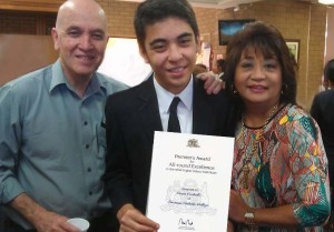 Gavin with proud parents, Gilly and Enialyn Carballo.